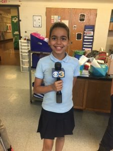 Broadcast club student with microphone